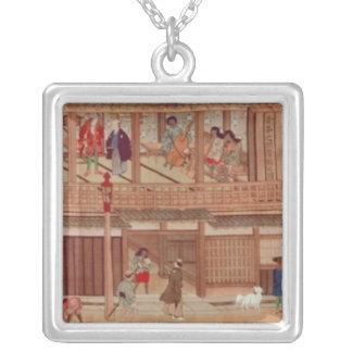 A domestic scene, scroll silver plated necklace