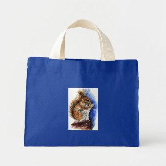 A Douglas Squirrel watercolor pencil Tote Bags