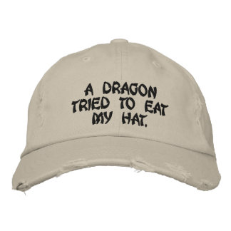 A dragon tried to eat my hat. baseball cap