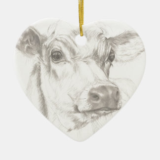 A drawing of a young cow ceramic heart decoration