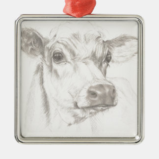 A drawing of a young cow christmas ornament