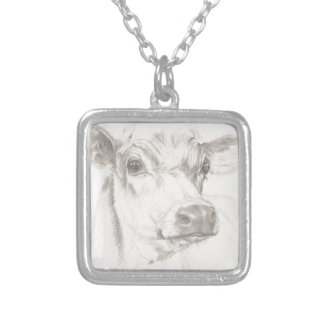 A drawing of a young cow silver plated necklace