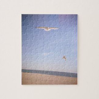 a dreamy image of seagulls flying at the beach puzzle