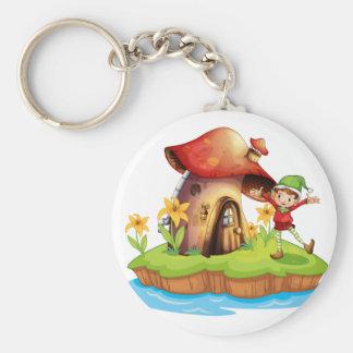 A dwarf outside a mushroom house basic round button key ring