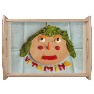 a face made of vegetables on large  serving tray