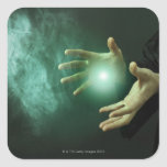 A fantasy wizard making magic with his hands. square stickers