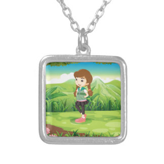 A fashionable young girl at the forest square pendant necklace