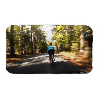 A female cyclist quickly rides on a small narrow iPhone 3 cover