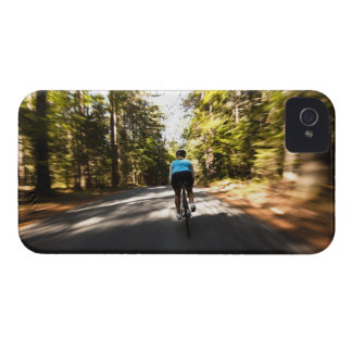 A female cyclist quickly rides on a small narrow iPhone 4 covers