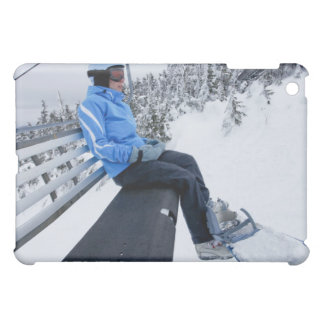 A female snowboarder rides the chair lift in New iPad Mini Cases