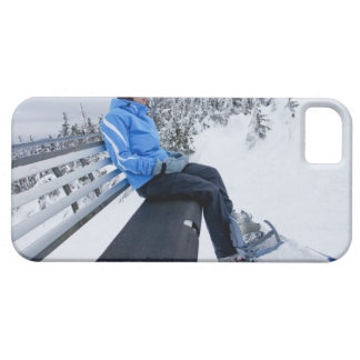 A female snowboarder rides the chair lift in New iPhone 5 Case