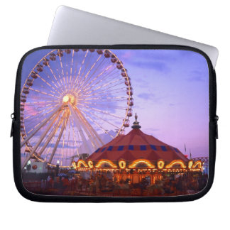 A ferris wheel and carousel at the Navy Pier in Laptop Sleeves