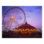 A ferris wheel and carousel at the Navy Pier in Poster