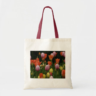 A field of peonies, cyclamens and tulips flowers tote bag