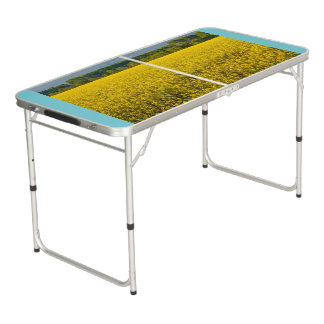 a field of yellow rapeseed flowers  pong table