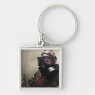 A field radio operator clears CS gas Silver-Colored Square Key Ring