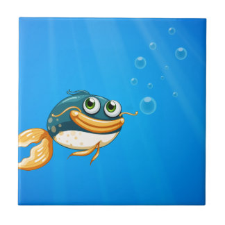 A fish with a big mouth under the ocean tile