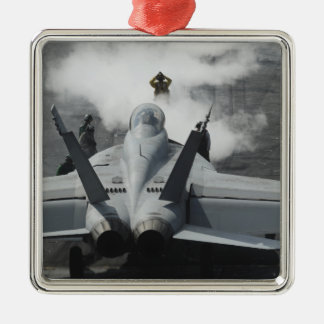 A flight deck director signals an F/A-18F Christmas Ornament