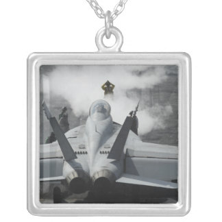 A flight deck director signals an F/A-18F Silver Plated Necklace