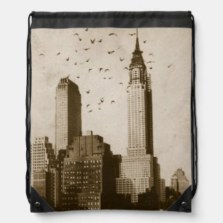 A flock of birds flying drawstring bag