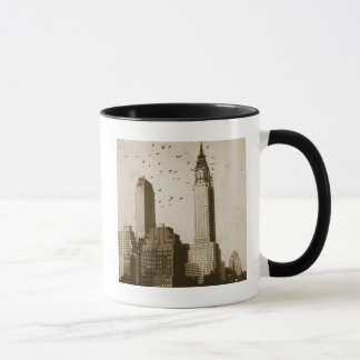 A flock of birds flying mug