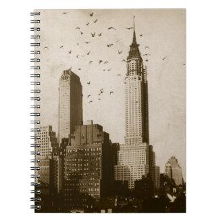 A flock of birds flying notebooks