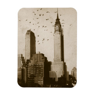 A flock of birds flying rectangular photo magnet