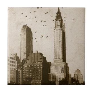 A flock of birds flying tile