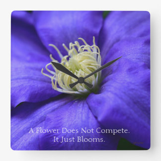 A Flower Does Not Compete Quote Wall Clocks