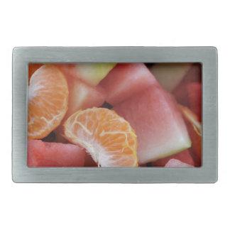 A fruit salad of melons and oranges belt buckle