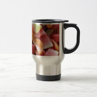 A fruit salad of melons and oranges stainless steel travel mug