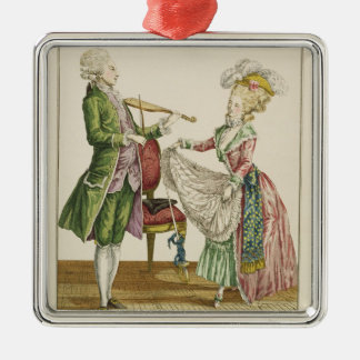 A gentleman playing the violin while a lady dances christmas ornament