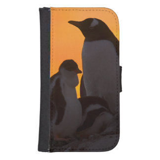 A gentoo penguin adult and chick are silhouetted samsung s4 wallet case