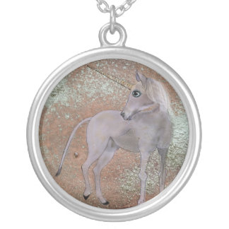 A ghostly unicorn silver plated necklace