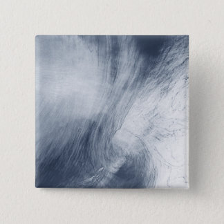 A giant whirlpool cloud swirls above the sea 15 cm square badge