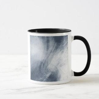 A giant whirlpool cloud swirls above the sea mug
