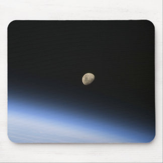 A gibbous moon visible above Earth s atmosphere 2 Mousepads