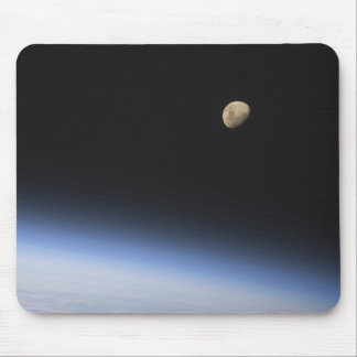 A gibbous moon visible above Earth s atmosphere Mousepads