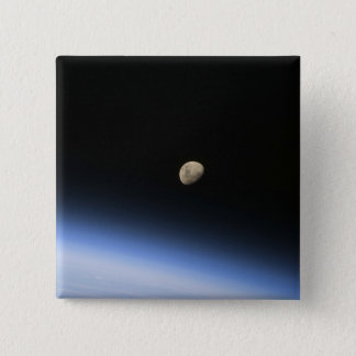 A gibbous moon visible above Earth's atmosphere 2 15 Cm Square Badge