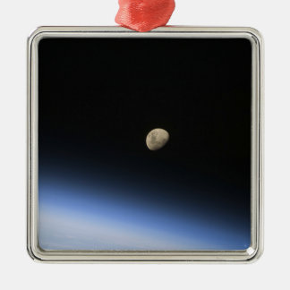 A gibbous moon visible above Earth's atmosphere 2 Square Metal Christmas Ornament