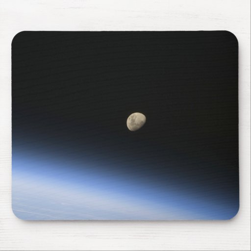 A gibbous moon visible above Earth's atmosphere 2 Mousepads