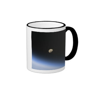 A gibbous moon visible above Earth's atmosphere 2 Mugs