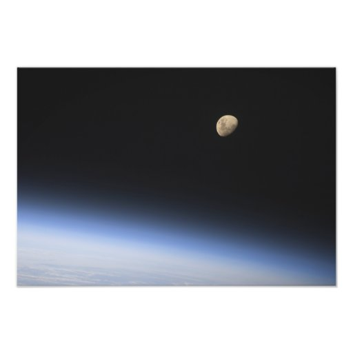 A gibbous moon visible above Earth's atmosphere 2 Photographic Print