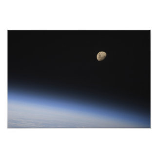 A gibbous moon visible above Earth's atmosphere 2 Poster