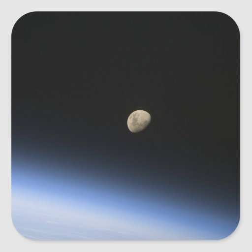 A gibbous moon visible above Earth's atmosphere 2 Stickers