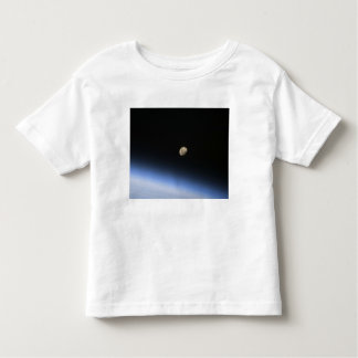 A gibbous moon visible above Earth's atmosphere 2 T Shirts