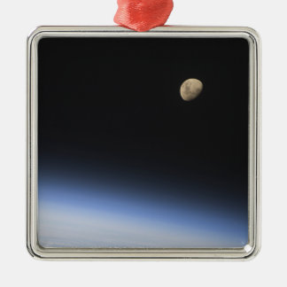 A gibbous moon visible above Earth's atmosphere Christmas Ornaments