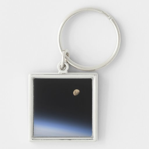 A gibbous moon visible above Earth's atmosphere Keychains