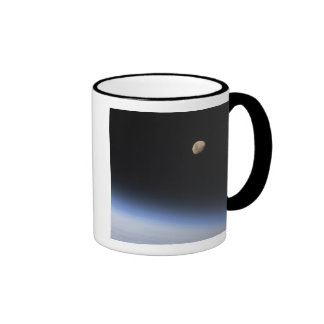 A gibbous moon visible above Earth's atmosphere Coffee Mugs
