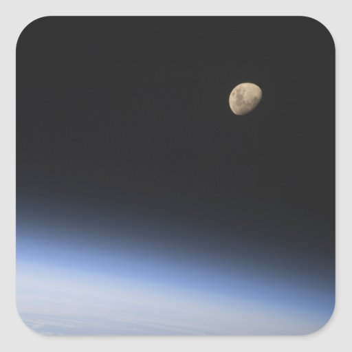 A gibbous moon visible above Earth's atmosphere Stickers